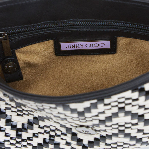 Purple Jimmy Choo name plate on the interior