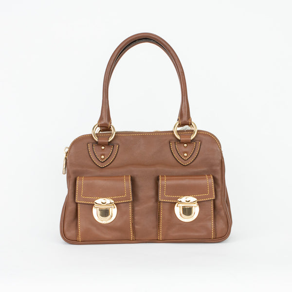 Marc Jacobs brown leather three compartment satchel handbag with two small exterior pockets with tuck lock clasp closures, dual handles, yellow accent stitching, and gold tone hardware.