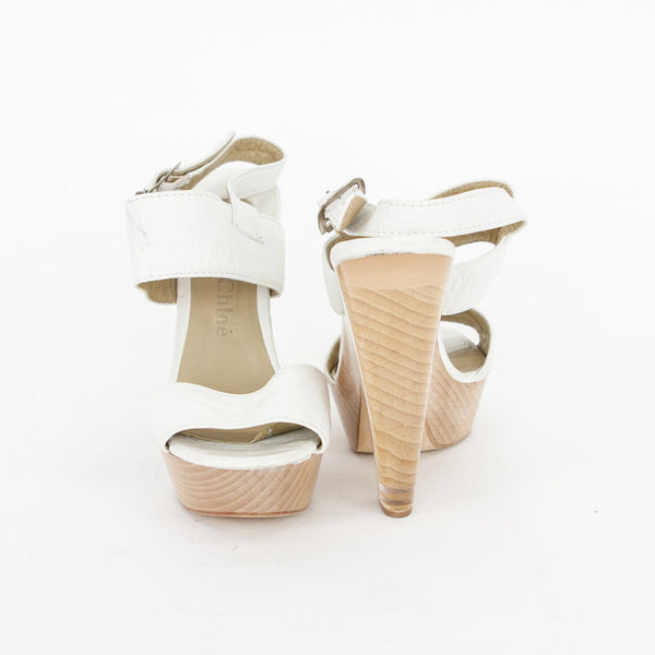 Chloe winter white leather sandals with lucite and wooden heel platforms and adjustable ankle straps.