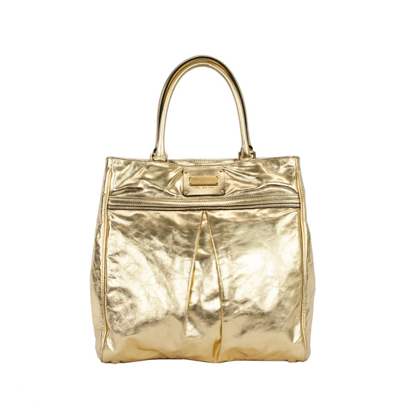 Marc Jacobs metallic gold leather tote with pleats on front and back, dual rolled leather handles, and snaps on sides to allow for expansion.