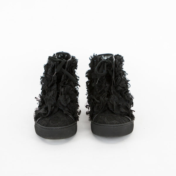 Chanel 2013-14 Camellia black high top sneakers with lace appliqué throughout and lace up closure.