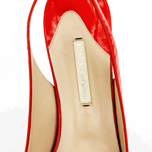 Nicholas Kirkwood red patent leather high heels with designer tag on insole