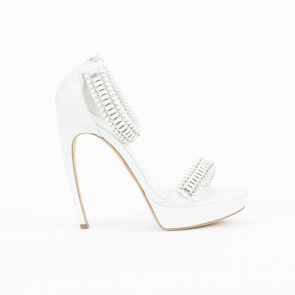 White & silver Alexander McQueen leather sandal pumps with a COMMA heels, small platform, whip-stitched ankle strap & upper with chain accents and  a back-zipper closure