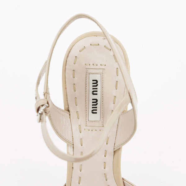 Miu Miu nude patent leather high heels with crystals with designer tag on insole