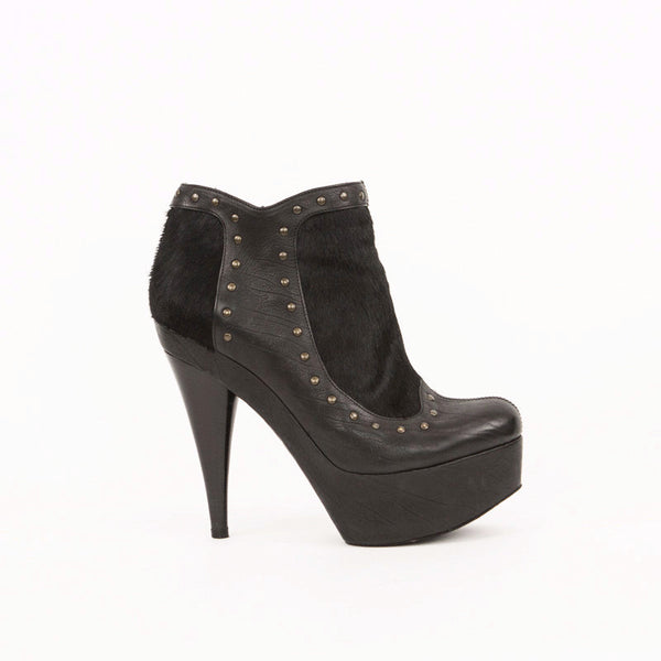 Fendi black leather and pony hair platform ankle booties with bronze studs.