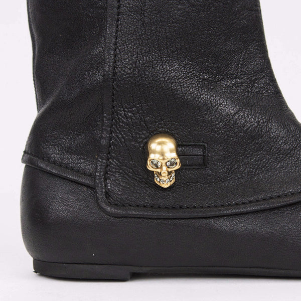 Alexander McQueen black leather boots with skull and crystals