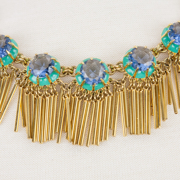 Lele Sadoughi 14k gold plated fringe necklace from the Tropicana Havana Collection with blue crystals and turquoise enamel set in gold plated setting.
