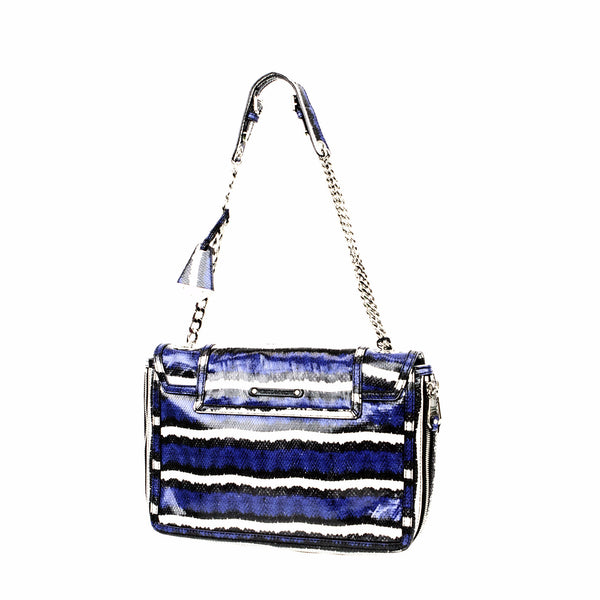 This shoulder bag is blue, black, and white embossed leather with silver tone hardware.