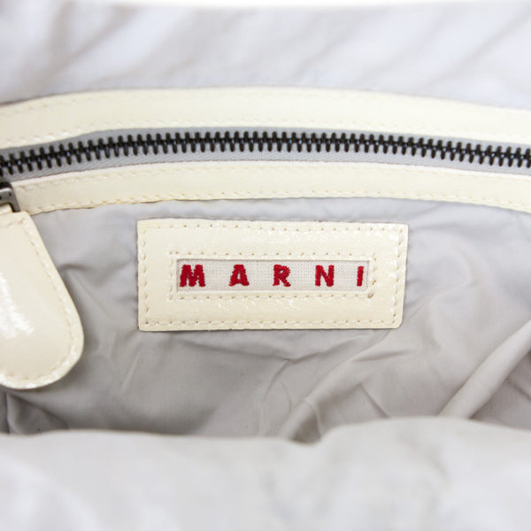 Marni 2008 Tinsel Fringe ivory patent leather framed handbag with brown leather flat handle and clasp closure.