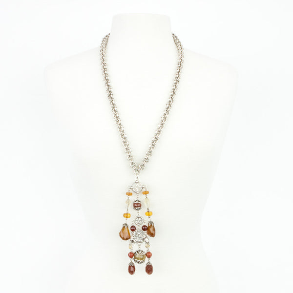 Stephen Dweck double linked silver chain necklace with dangling carnelian and floral motif with cascading quartz drop.