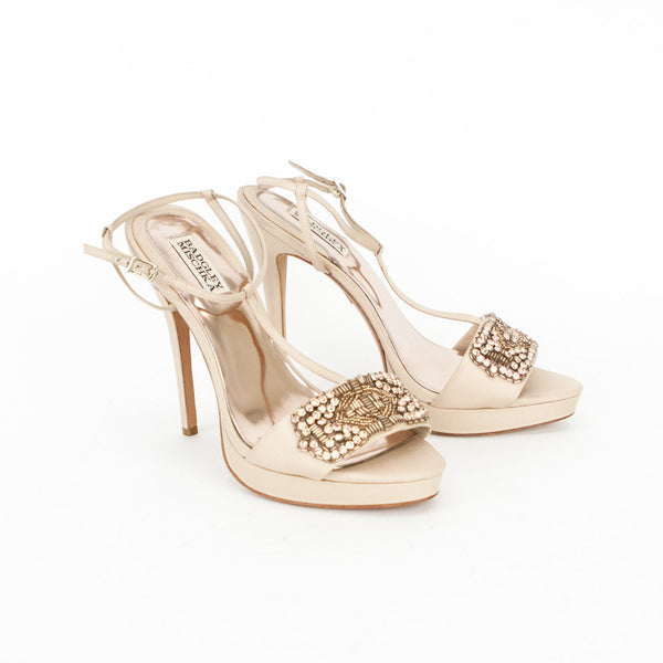 Badgley Mischka beige satin t-strap pumps with rhinestones and beads across vamp, covered heels, and adjustable ankle straps.