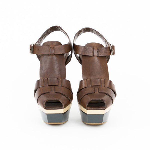 Marni brown leather platform peep toe sandals with woven top, wooden heels, and adjustable ankle straps.