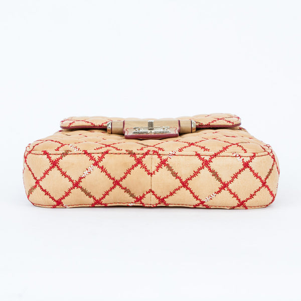 Olivia Harris gustavia quilted handbag with diamond pattern red accent top stitching, flap over with turnlock closure, and gold tone chain strap.