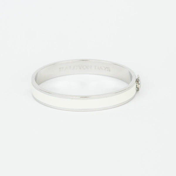 Halcyon Days ivory enamel with silver-tone trim hinged bangle bracelet with designer branding on the inside.