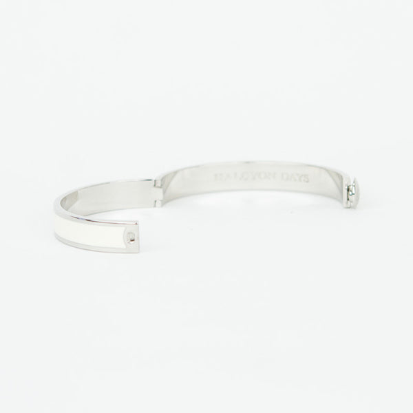 Halcyon Days ivory enamel with silver-tone palladium trim hinged bangle bracelet with designer branding on the inside.  Snapped hinge closure