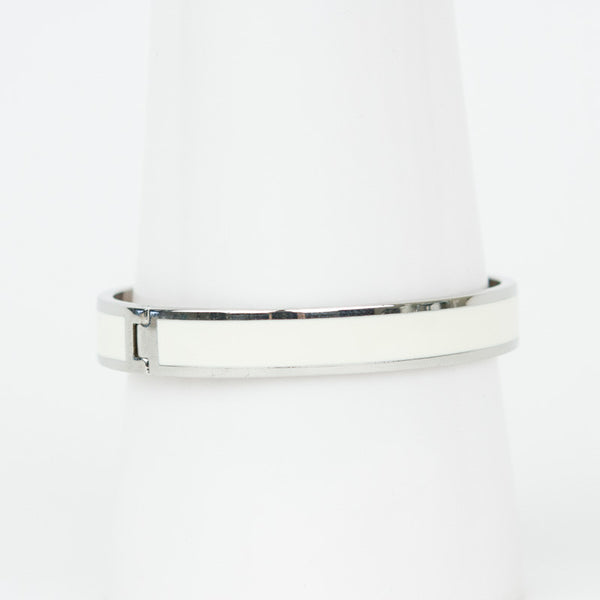 Halcyon Days ivory enamel with silver-tone palladium trim hinged bangle bracelet with designer branding on the inside