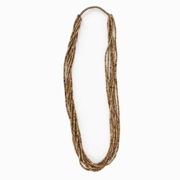 Eskandar multi strand stacked tube bead tan necklace.
