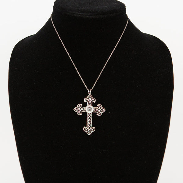 Jude Frances black fleur cross pendant trimmed and detailed in silver with a rhinestone accent in the middle.
