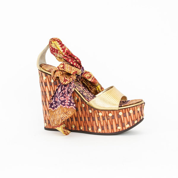 Giuseppe gold textured leather sandal with basket weave detail on wedge with gold stud accents and multi color ankle tie.