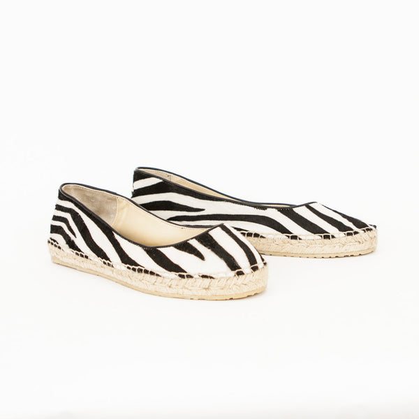Jimmy Choo Pow zebra print pony hair slip on espadrilles with round toes and rubber soles.
