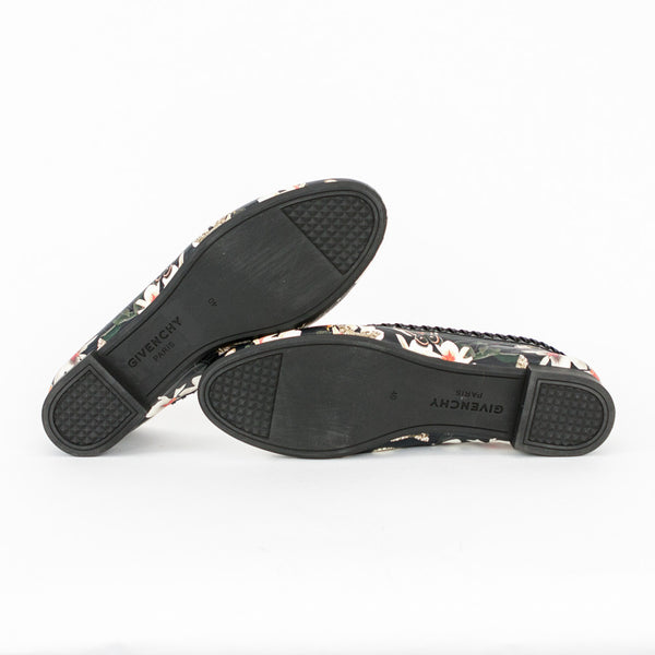 Givenchy black leather magnolia floral print ballet flats with whip stitch patent leather trim and rubber soles