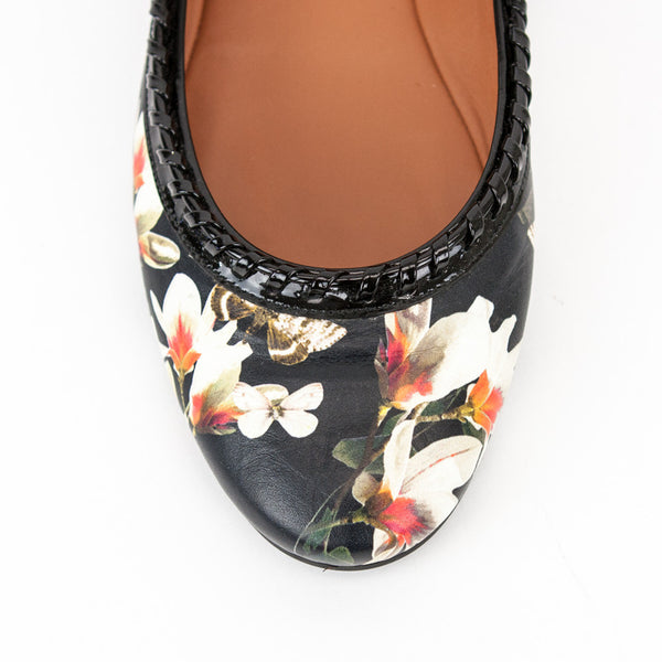 Givenchy black leather magnolia floral print ballet flats with whip stitch patent leather trim, round toes and rubber soles
