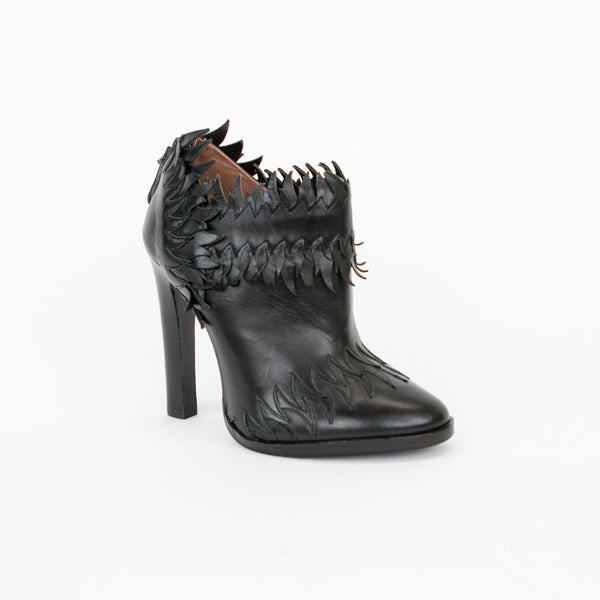 Alaia black high heel black leather booties with flame accents, round toes, and stacked heels.