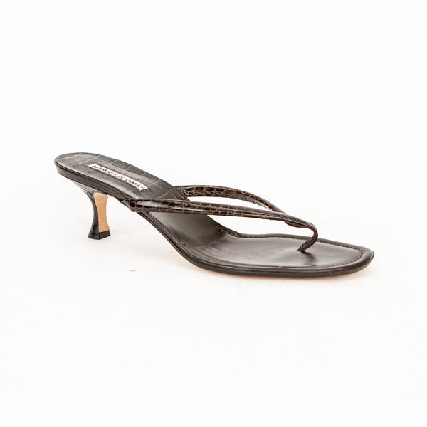 Manolo Blahnik alligator embossed thong style sandals with covered heels.