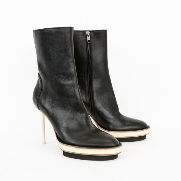 Ann Demeulemeester black leather mid calf platform booties with stiletto heels and side zip closures.