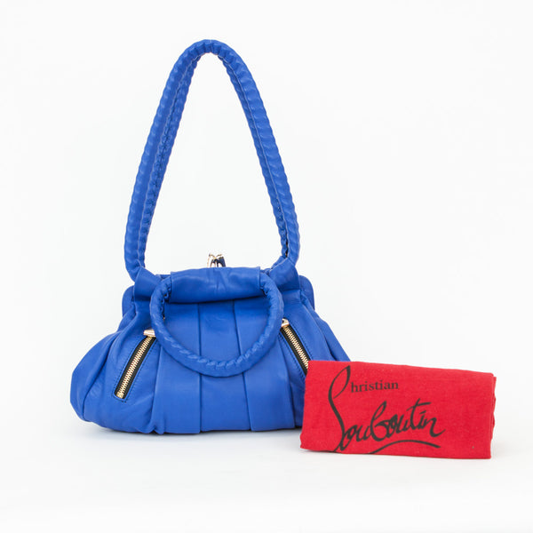 2008 Christian Louboutin loubette small leather shoulder bag with pleated front and back, high heel kissing lock closure, and two front exterior zip pockets with half bow zip pulls. With dust bag