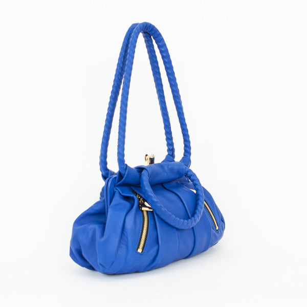2008 Christian Louboutin loubette small leather shoulder bag with pleated front and back, high heel kissing lock closure, and two front exterior zip pockets with half bow zip pulls.