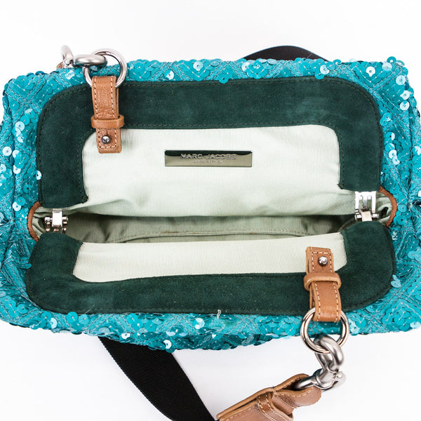 Marc Jacobs turquoise sequined crossbody frame bag with detachable shoulder strap and suede trim with frog accessory on front.