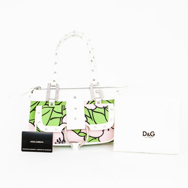 Dolce Gabbana pink, green, and white cloth baguette handbag with white patent leather trim embellished with Swarovski crystals. Dust Bag and Authentication card included