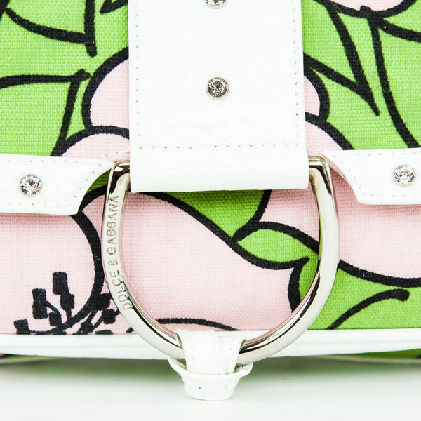 Dolce Gabbana pink, green, and white cloth baguette handbag with white patent leather trim embellished with Swarovski crystals.
