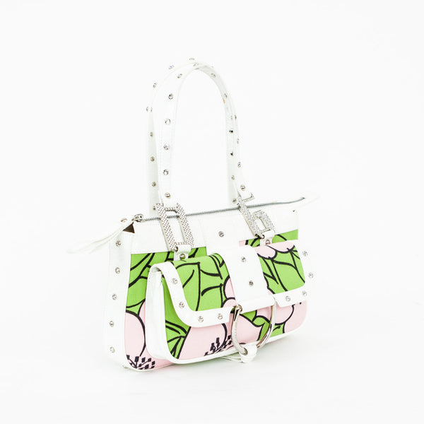 Dolce Gabbana pink, green, and white cloth baguette handbag with white patent leather trim embellished with Swarovski crystals. Front flap pocket