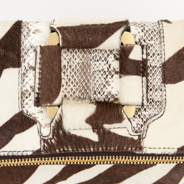 Jimmy Choo ponyhair zebra print Marin clutch with wristlet strap, python detail, and gold tone hardware.