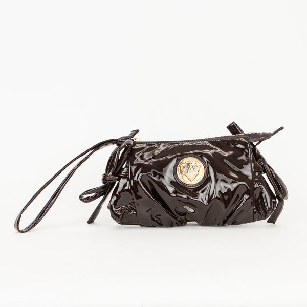 Gucci Hysteria brown patent leather wristlet with ruched bottom, bow detail on sides, and gold tone Gucci emblem on front.