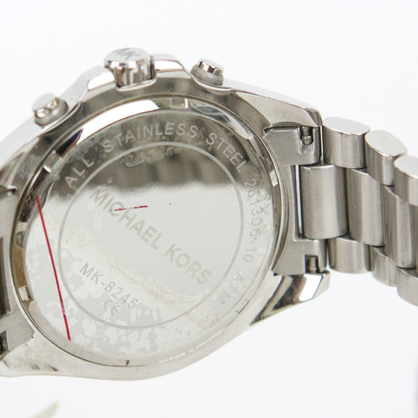 Michael Kors Bradshaw silver watch stamped on the back