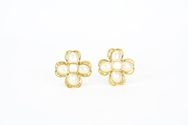 Chanel Vintage Spring 1994 Collection earrings in goldtone four leaf clover setting with acrylic pearl cabochons.