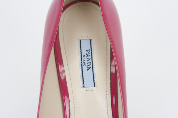 Prada fuchsia high heels with designer tag on the insoles