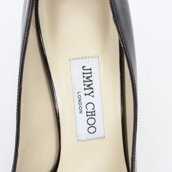 Jimmy Choo animal patent leather heels with designer tag on insoles