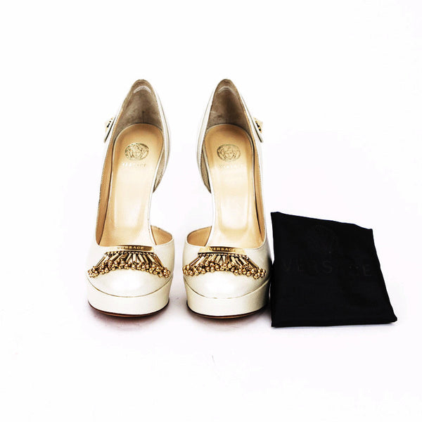 Versace ivory heels with gold accents and tonal stitching.