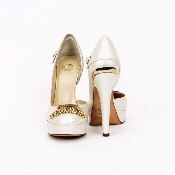 The rounded toe has Versace logo on gold plating with dangling accents.