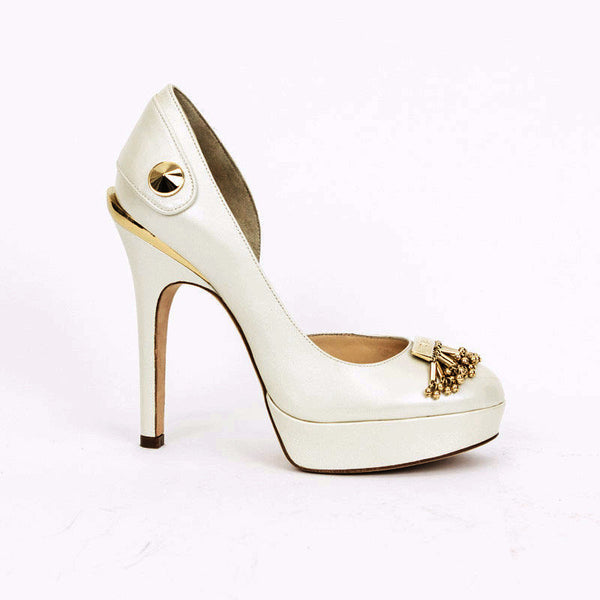 Versace ivory heels with gold accents.