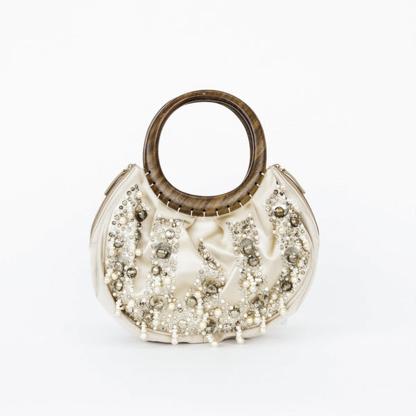 Oscar De La Renta champagne colored satin cocktail handbag with pearl, bead, rhinestone, brass embellishments & dual wooden handles.