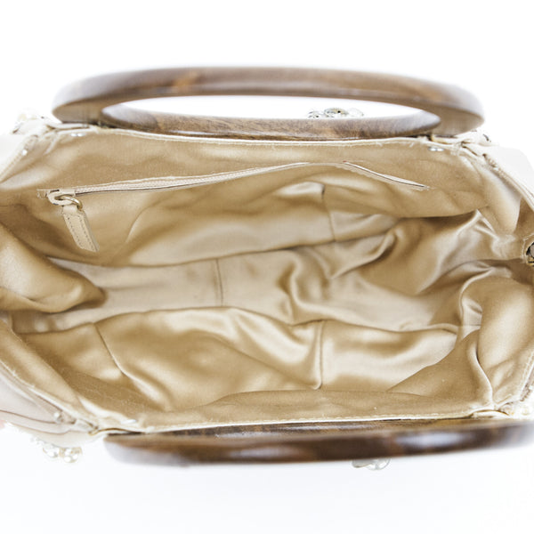 Oscar De La Renta champagne colored satin cocktail handbag with pearl, bead, rhinestone, brass embellishments & dual wooden handles With Interior Zip Pocket