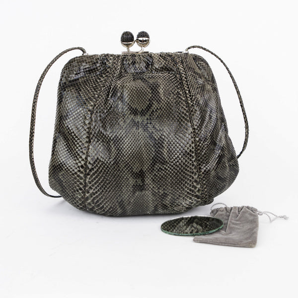 Judith Leiber olive and black snakeskin shoulder bag with frame, snakeskin covered kissing lock closure, stainless steel hardware, and pocket mirror included.