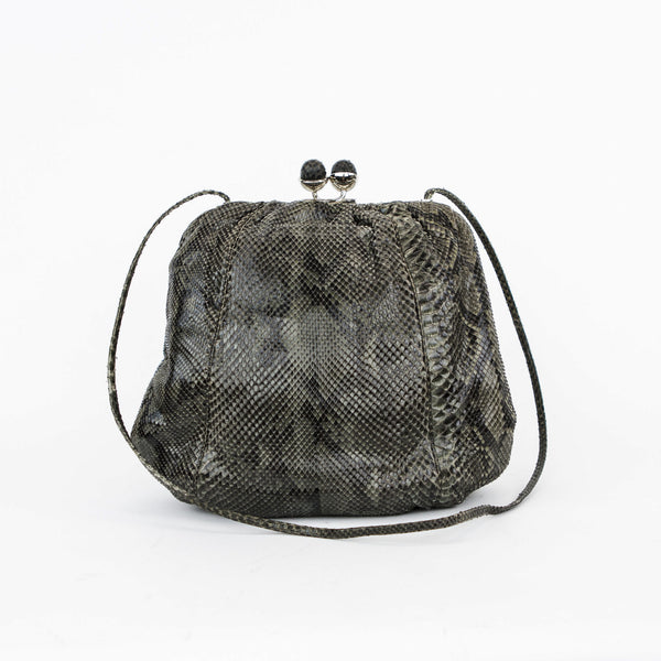 Judith Leiber olive and black snakeskin shoulder bag with frame, snakeskin covered kissing lock closure, and stainless steel hardware.