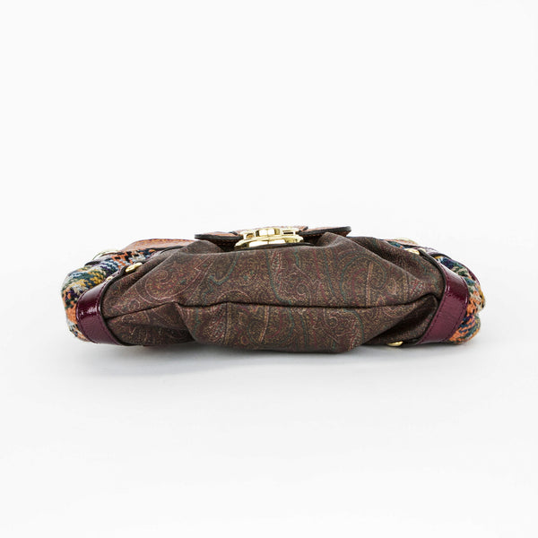 Shoulder bag from Etro with lizard embossed leather, paisley print coated canvas, knitted sides, and flap over with push lock closure with logo engraved on gold tone hardware.
