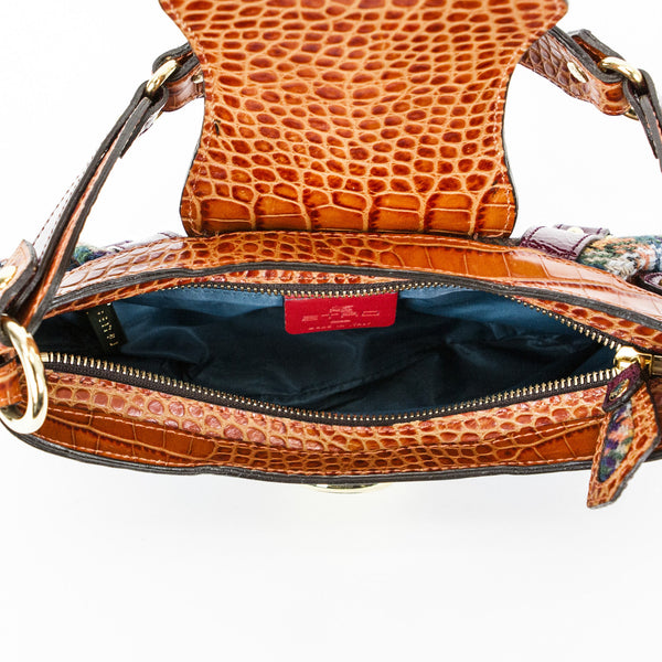 Etro shoulder bag with blue lining and leather logo tag on the interior